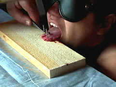 Tongue nailed to board